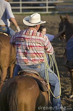Cowboy on horse with rope Editorial Stock Photo