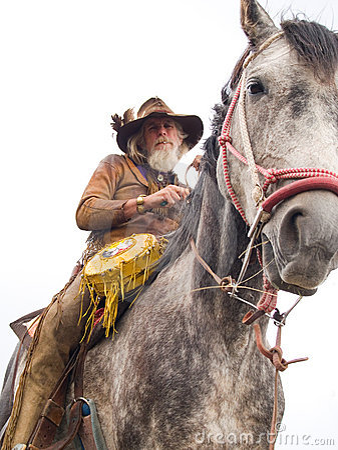 Cowboy on a horseback isolated