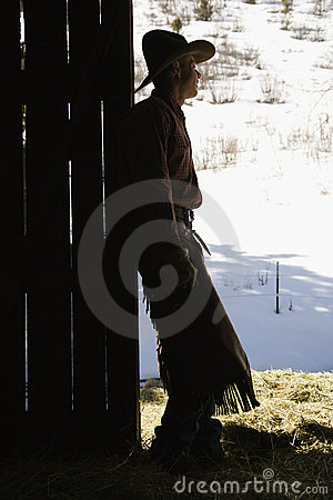 Free Cowboy Leaning In Doorway Of Barn Stock Image - 12986161
