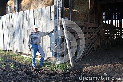 Cowboy By a Rustic Barn