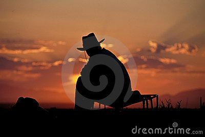 Cowboy silhouette against sunrise