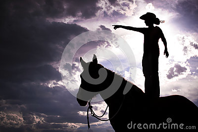 Cowboy Silhouette Standing on Horse
