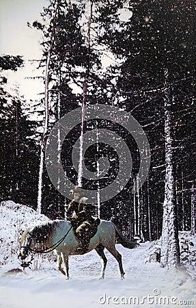 Cowboy into snowy landscape