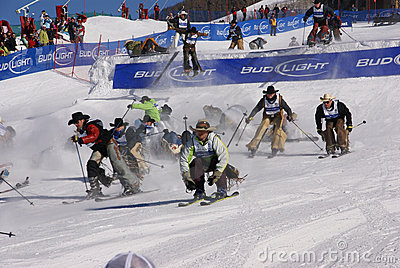 Cowboy Stampede - mass start of skiing cowboys Editorial Stock Photo