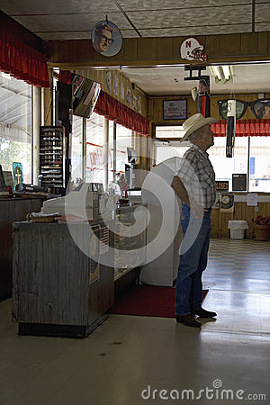 Cowboy standing inside of Hokes Cafe Editorial Photography