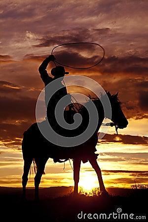 Free Cowboy Swinging Rope On Horse Side Angle Royalty Free Stock Photo - 26833485