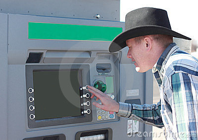 Cowboy Using ATM Machine