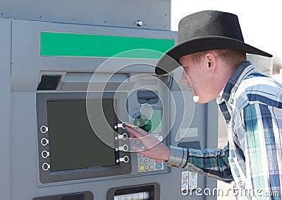 Cowboy Using ATM Machine