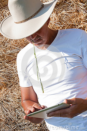 Cowboy using tablet computer