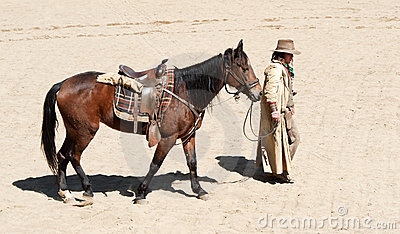 Cowboy walking his horse