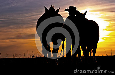 Cowboy Walking With Horses