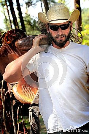 Free Cowboy With Saddle Stock Photography - 55995392
