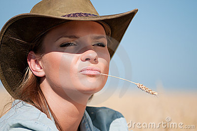 Cowboy woman in country wheat field