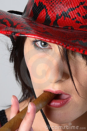 Cowboy woman smoking cigar