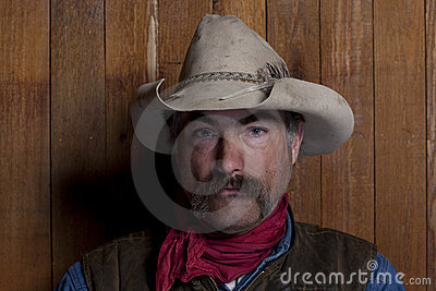 Cowboy By a Wood Wall