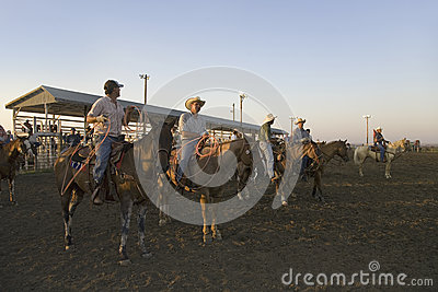 Cowboys at sunset at PRCA Rodeo Editorial Photography