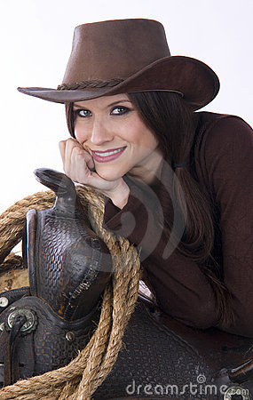 Free Cowgirl Candid Woman Leans On Saddle Gear Stock Photo - 18575260