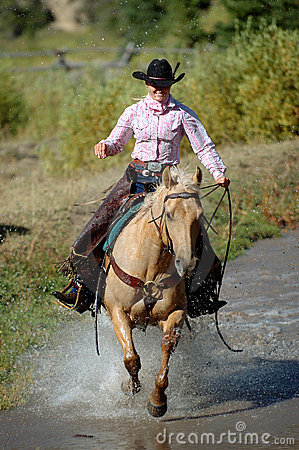 Free Cowgirl Crossing Pond Stock Photos - 263333
