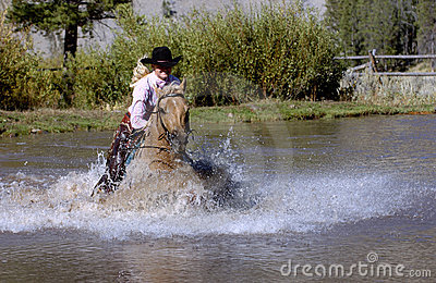 Cowgirl Galloping Horse into Pond
