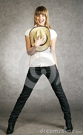 Cowgirl with a hat on a grey background