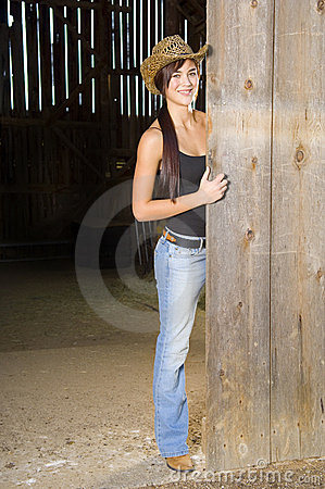 Free Cowgirl In Barn Doorway Royalty Free Stock Image - 14823936