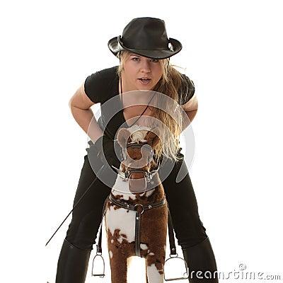 Free Cowgirl (jockey) Race On Hobbyhorse Stock Photos - 9503963