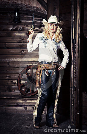 Cowgirl in the stables