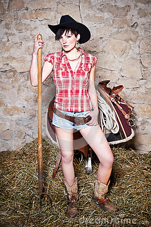 Free Cowgirl With Hay Fork Stock Images - 32029324