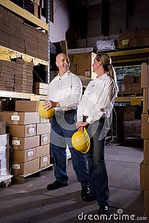 Coworkers in office storage room