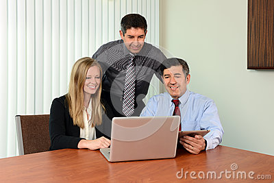 Coworkers Sharing Information on Laptop