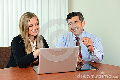 Coworkers Viewing Information on Laptop