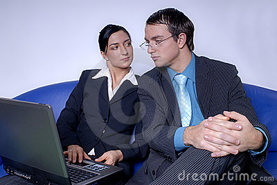 Coworkers working on laptop