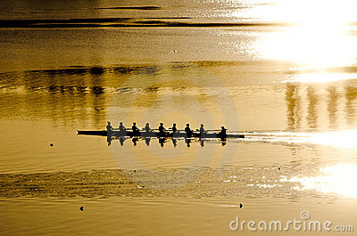 Rowing crew at sunrise