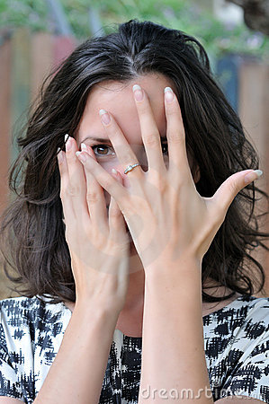 Coy woman with engagement ring