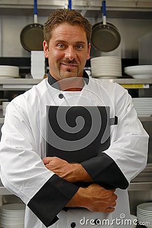 Cozinheiro chefe com menu