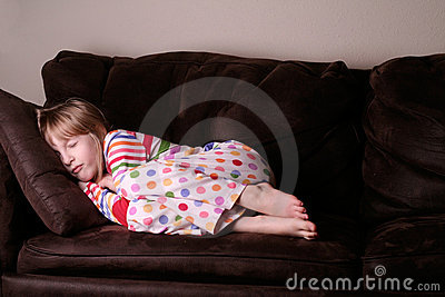 Cozy asleep in pajamas on sofa