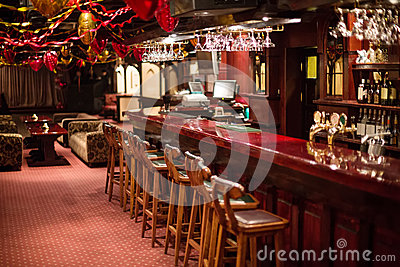 The cozy Karaoke - Club PHARAOH with wooden chairs and decorations Editorial Image