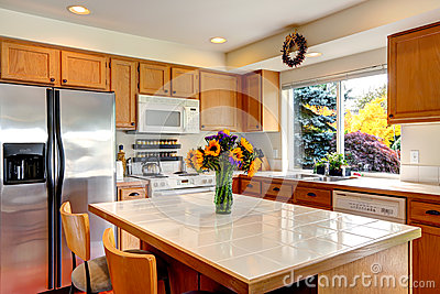 Cozy Kitchen With Honey Color Cabinets White Appliances And Kitchen