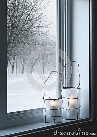 Cozy lanterns and winter landscape