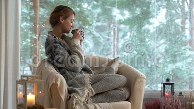 18c91d349f9 Young Happy Woman Drinking Cup Of Coffee Wearing Knitted Sweater Sitting  Home By The Big Window Stock Video - Video of drink, clothes: 104895435