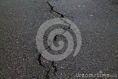 Crack in the road pavement Stock Photo