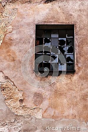 Cracked wall and broken window