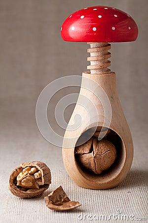 Cracked walnuts, nut kernel, shell, nutcracker