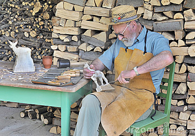 Craftsman carving wooden animals