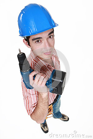 Craftsman holding a drill