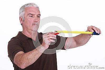 Craftsman holding a meter