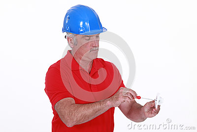 Craftsman holding a screwdriver