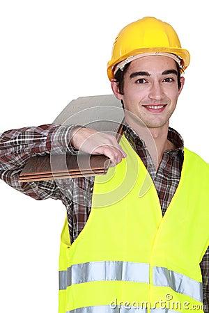 Craftsman holding floor tiles
