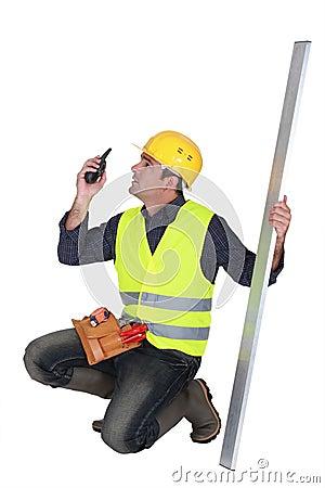Craftsman holding a walkie talkie