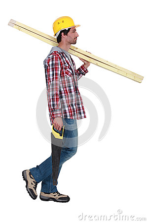 Craftsman holding wooden boards